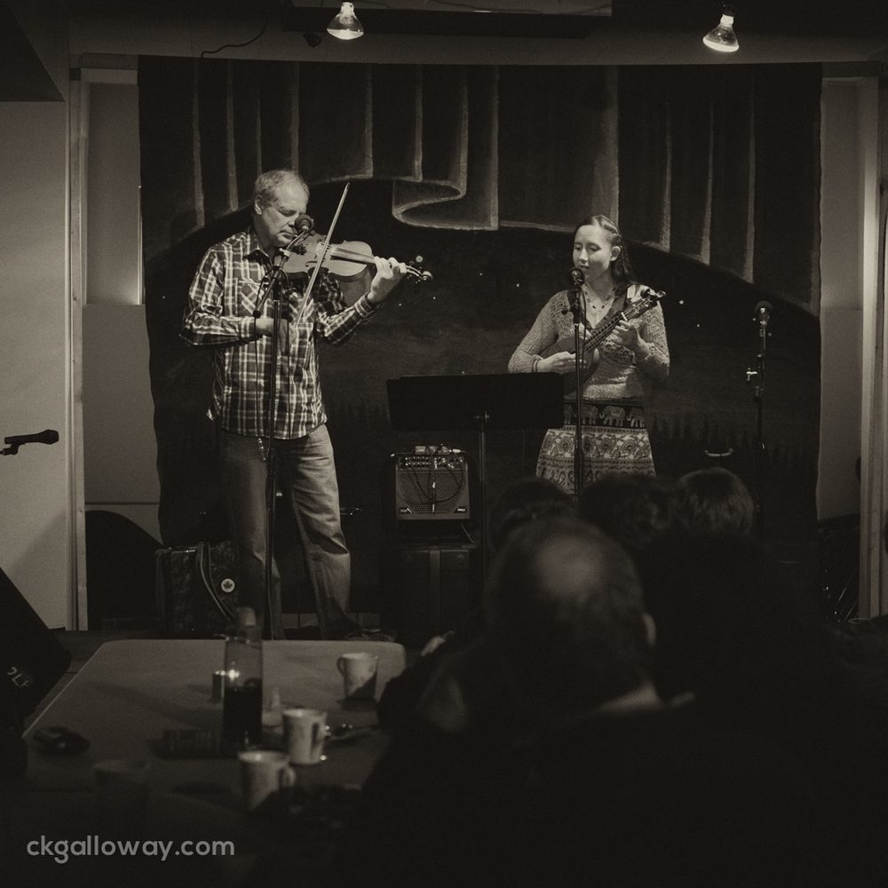 """Chic Callas and Erin Evangeline perform """"My First Fish"""" by Erin Evangeline at the Alaska Yukon Coffee House put on by the Whitehorse Folk Society on Saturday."""