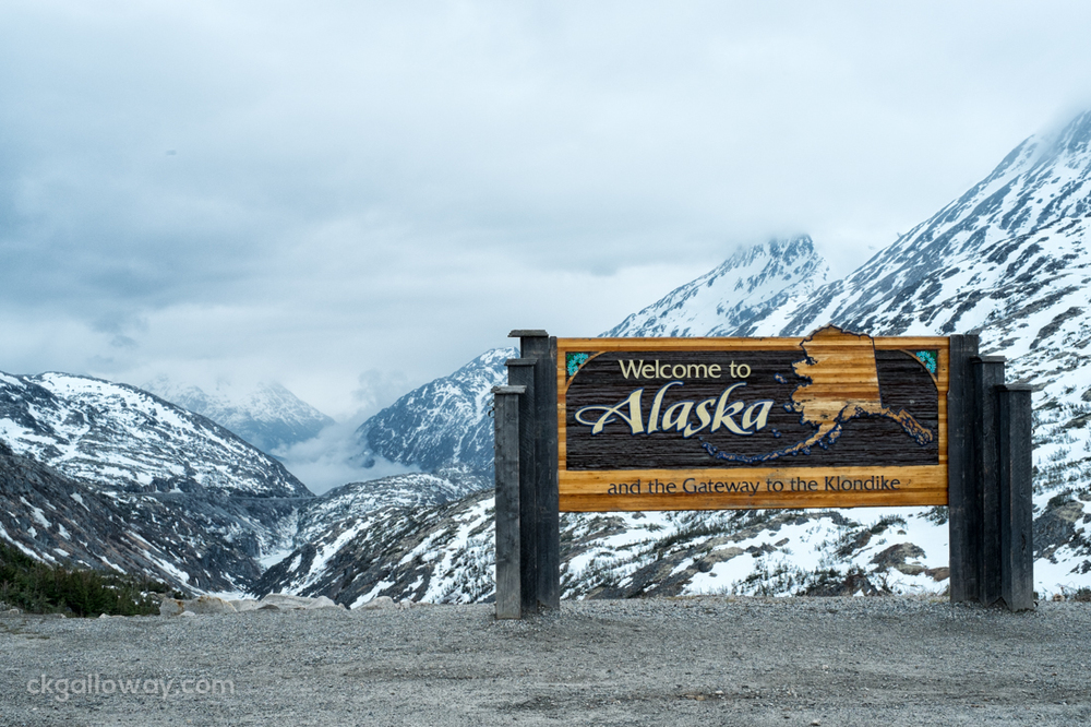 A welcome sign near the Alaska border on the Klondike Highway at White pass on the Coast Mountains. Photo by Christa Galloway.