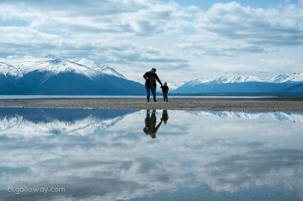 Father and son enjoying some family time on the beach at Atlin Lake.  Photo by Christa Galloway.