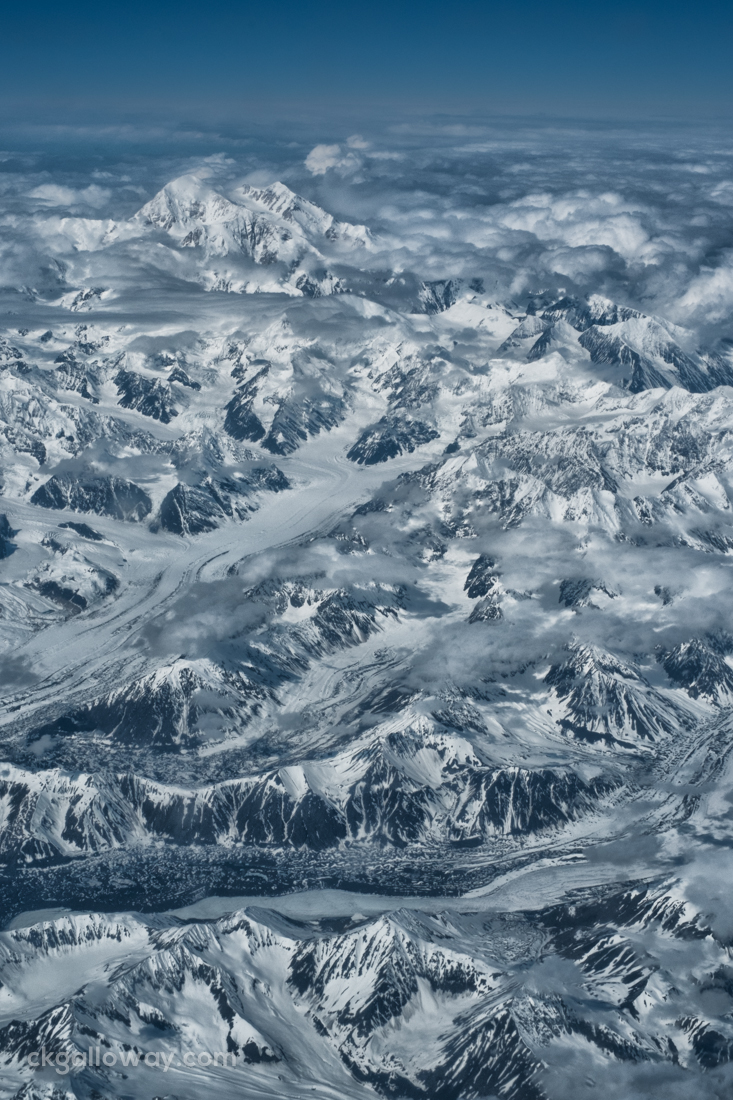 An ariel view of Mount McKinley, the highest mountain in North America with several glaciers in the foreground.  Photo by Christa Galloway.