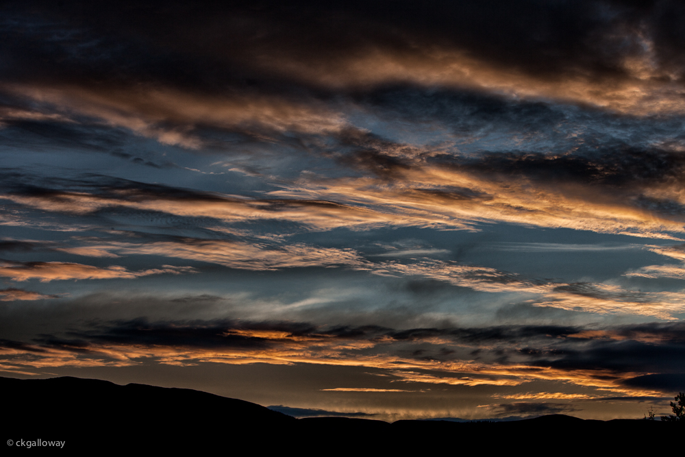 Striking clouds at sunset near Whitehorse, Yukon.  Photo by Christa Galloway.