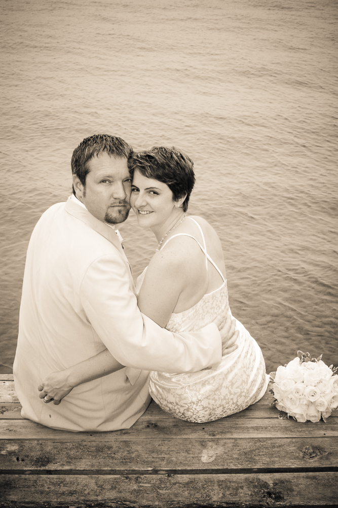 Richard and I sitting on the dock on our wedding day.  Photo by Simon Furlong.
