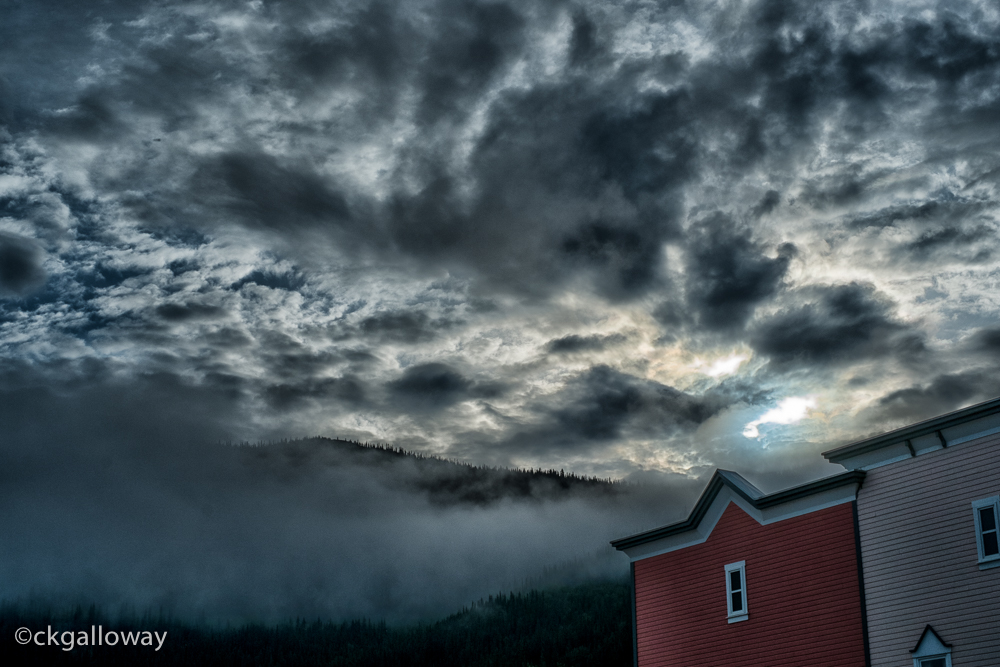 A view of the morning sun and low clouds  from the Westmark in Dawson.  Photo by Christa Galloway.