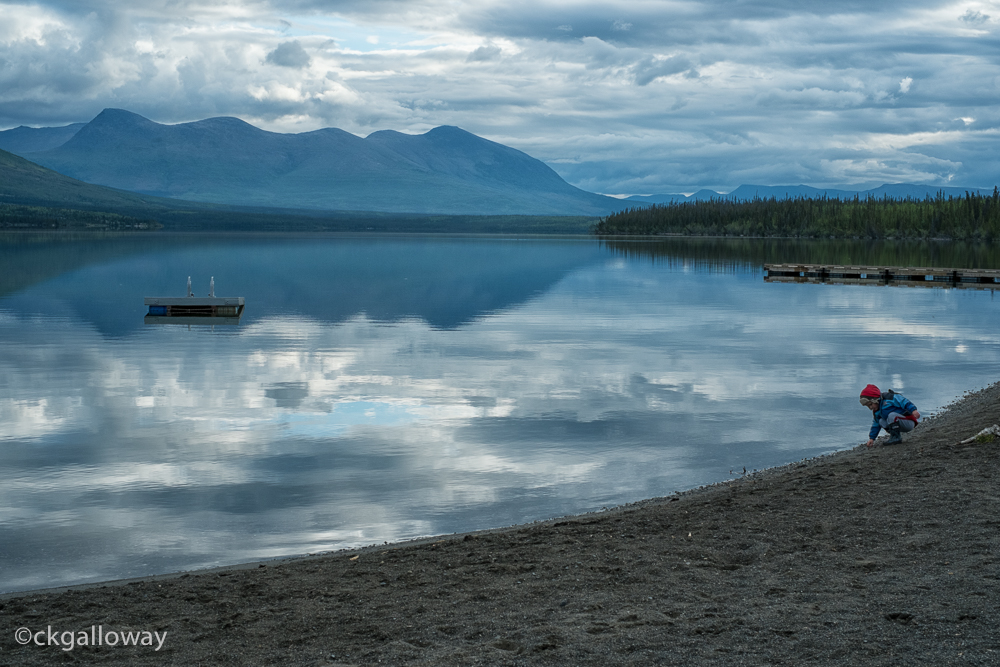 Oscar enjoying a peaceful morning at Pine Lake, Yukon.