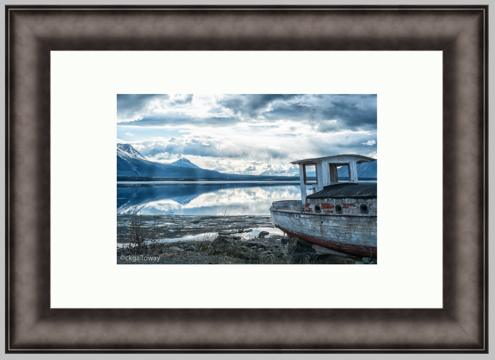 "Abandoned Boat, 12"" X 18"" iron frame, 8"" X 12"" print with a double white mat. $190"
