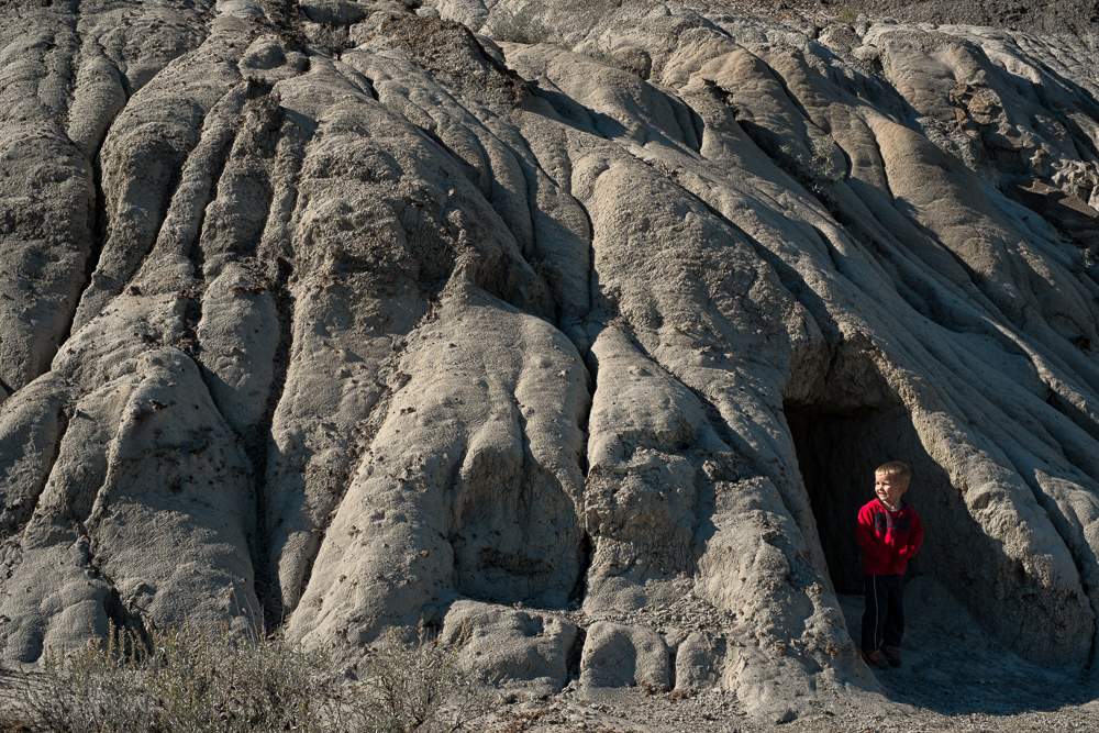 Oscar exploring caves in the badlands.  Photo by Christa Galloway.