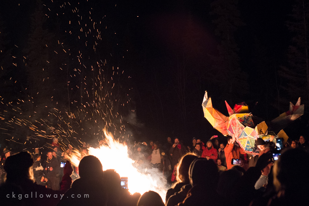 An effigy is thrown into a bonfire at the Burning away the Winter Blues event in Whitehorse, 2015.  Photo by Christa Galloway.