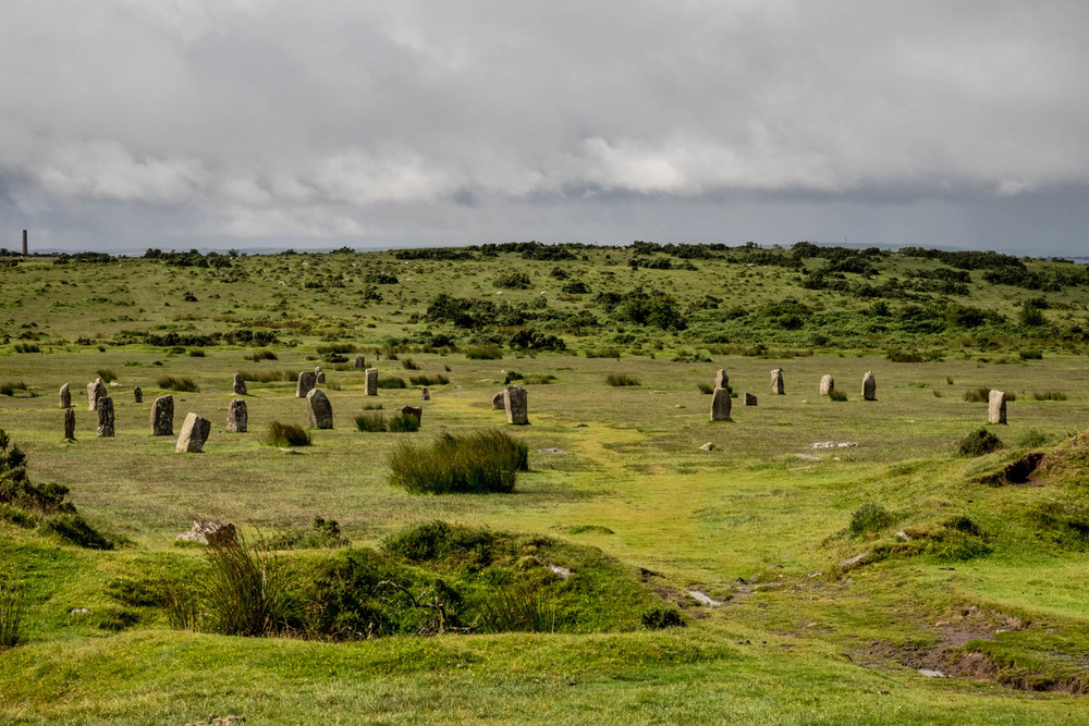 Part of the Hurlers, neolithic stone circles near Minions, Cornwall. In the background is an abandoned mine. Photo by Christa Galloway.