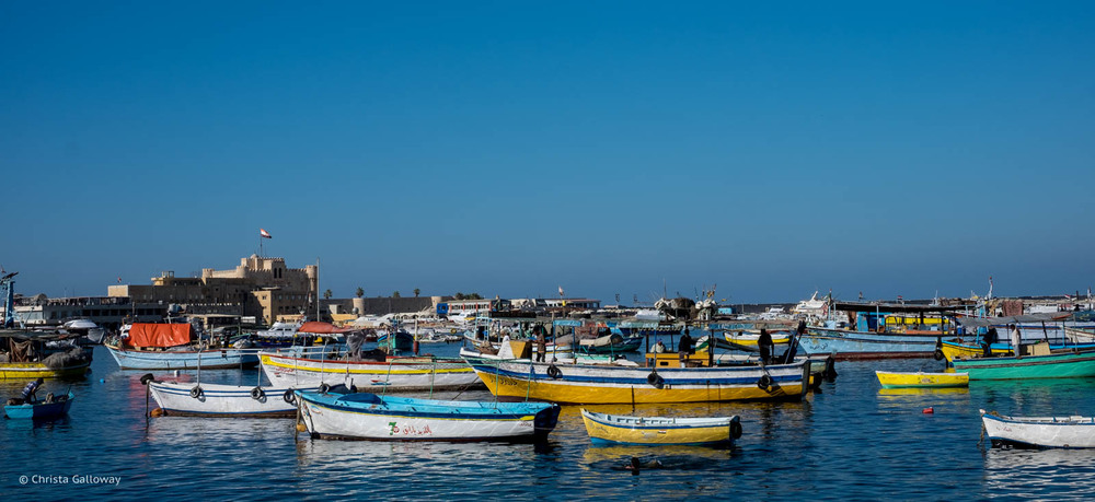 Boats on the Mediterranean coast near the Qaitbay Citadel.