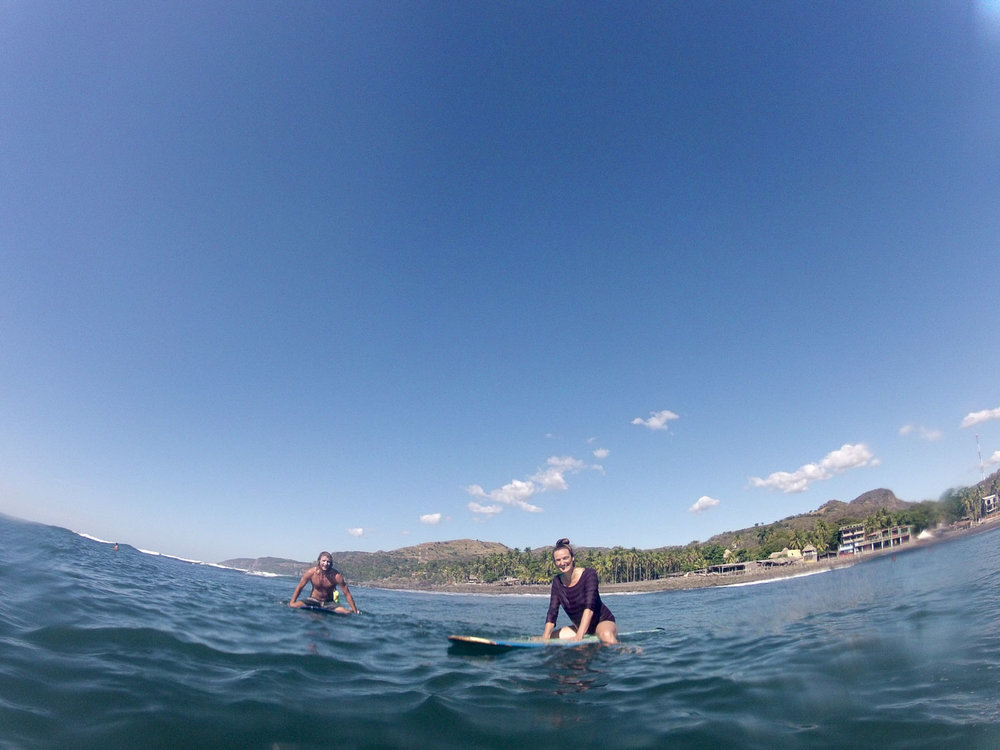 Matty and Saskia waiting for a wave