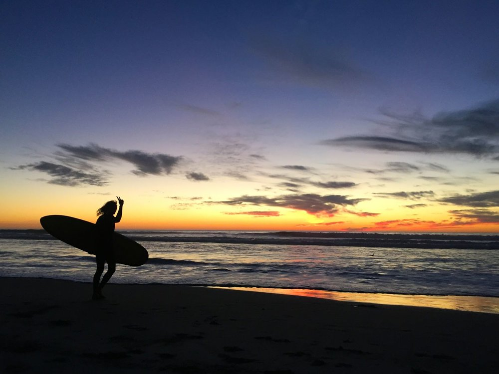 Surfing La Mision at sunset