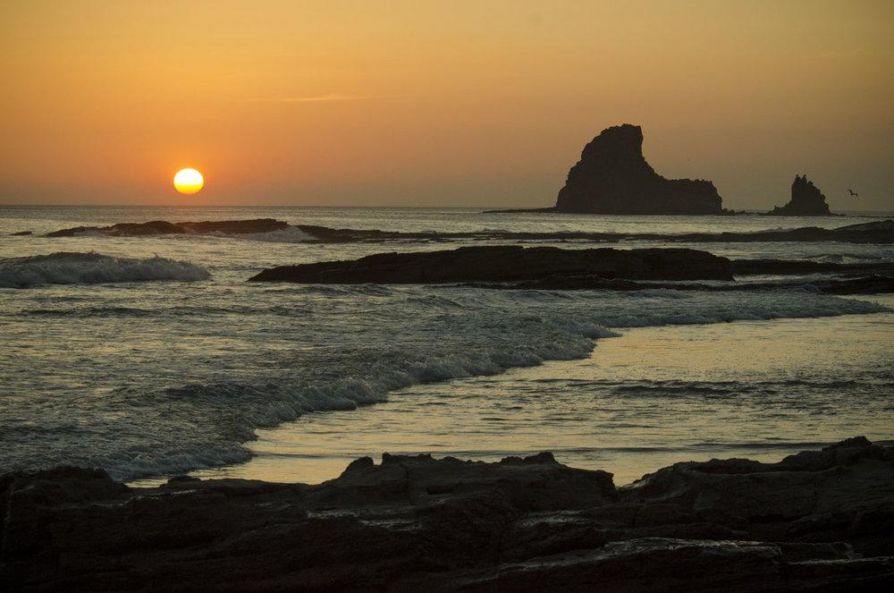 Shark fin rock standing tall at sunset
