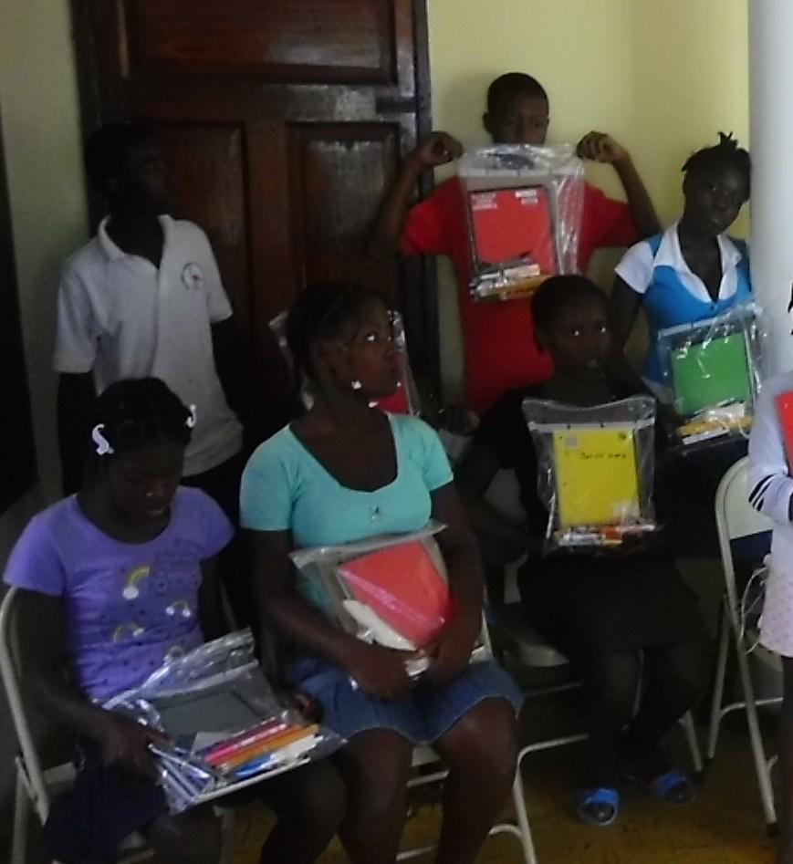 Girls with school supplies