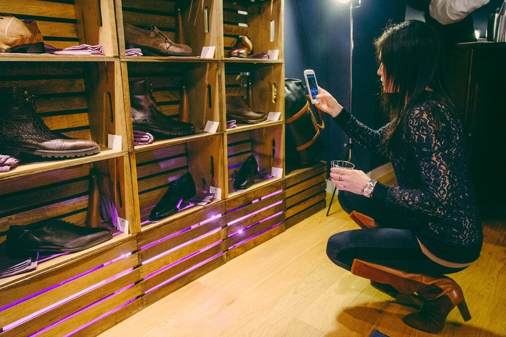 That's me, checking out the shoes at the Paul Drish launch party.