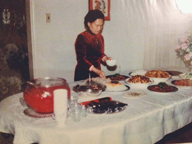 Grandma in the '80s – not her eighties but the 1980s – adding the finishing touches to one of her first meals cooked in the U.S.A.