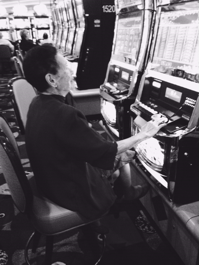 Mom snaps a pic of Po-Po hitting the slots.