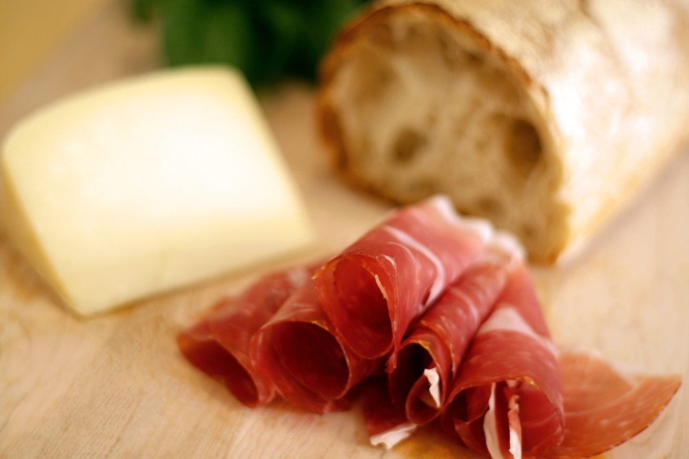 La Quercia Prosciutto, a world famous dry-cured ham made in Norwalk, Iowa, is featured on our menu.