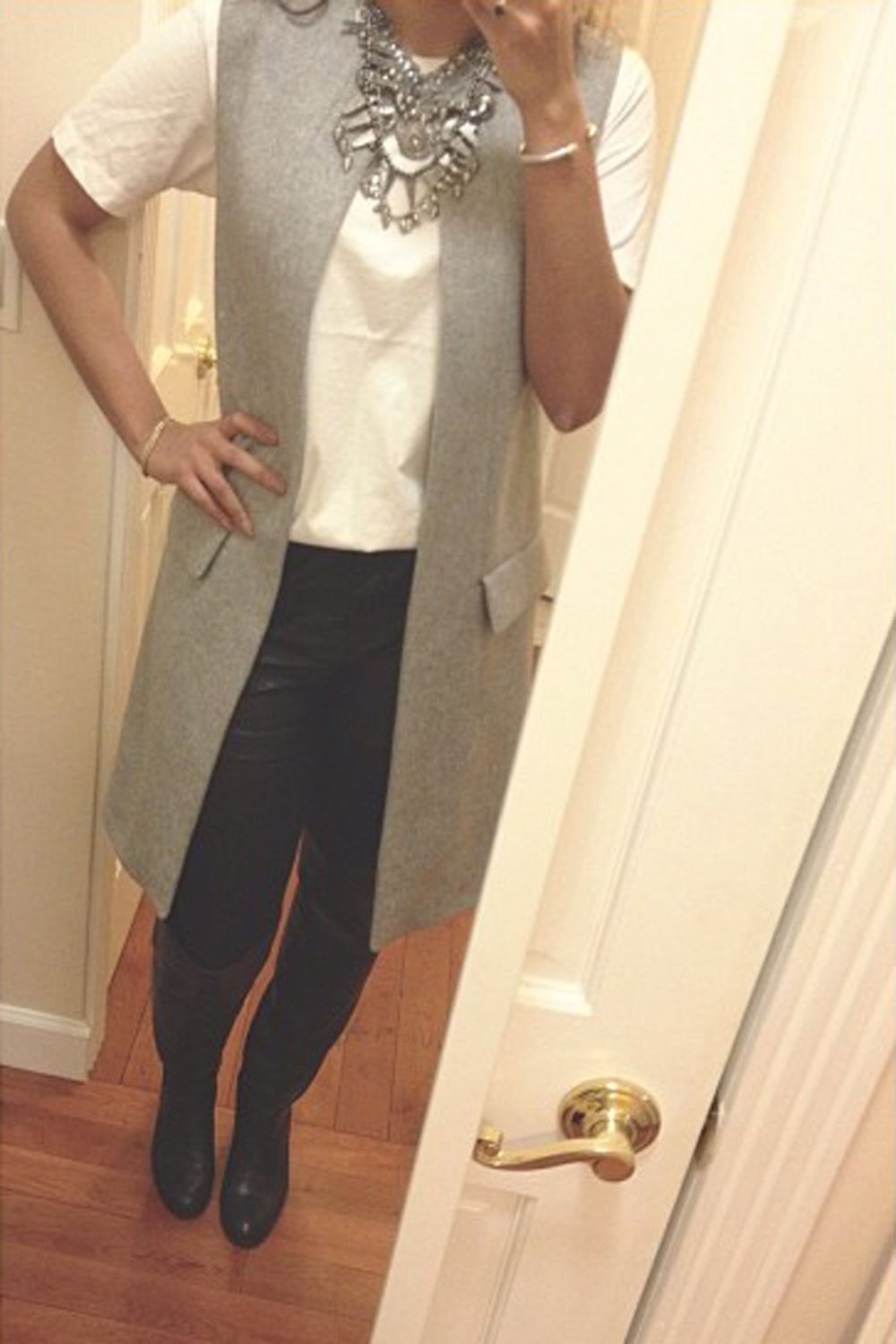 Wearing: Zara Necklace, Vest, & Boots, H&M Shorts
