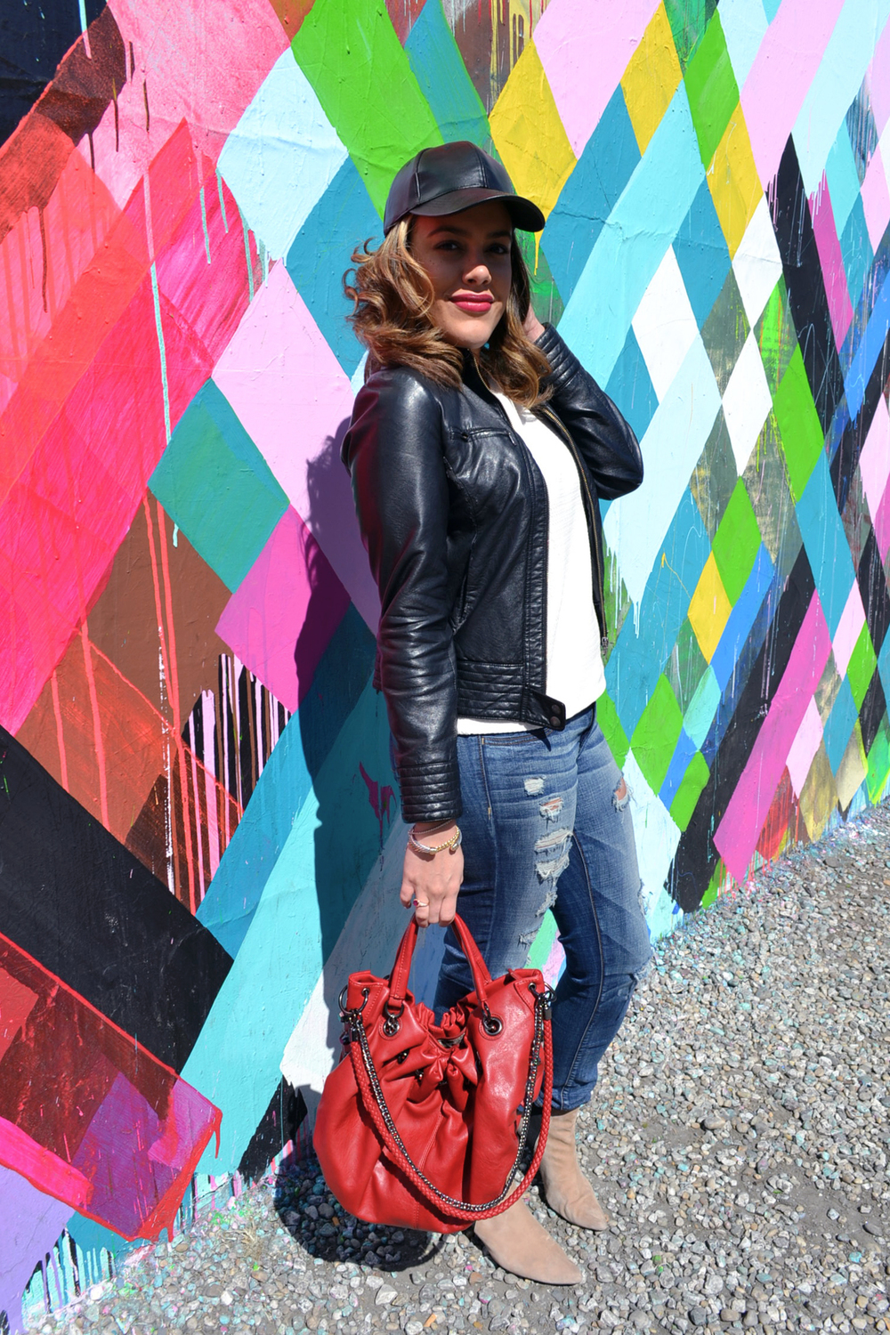 how-i-wear-minus-the-leather-sleeve-top-just-fab-bag-distressed-jeans-zara-booties-and-leather-cap-2.jpg
