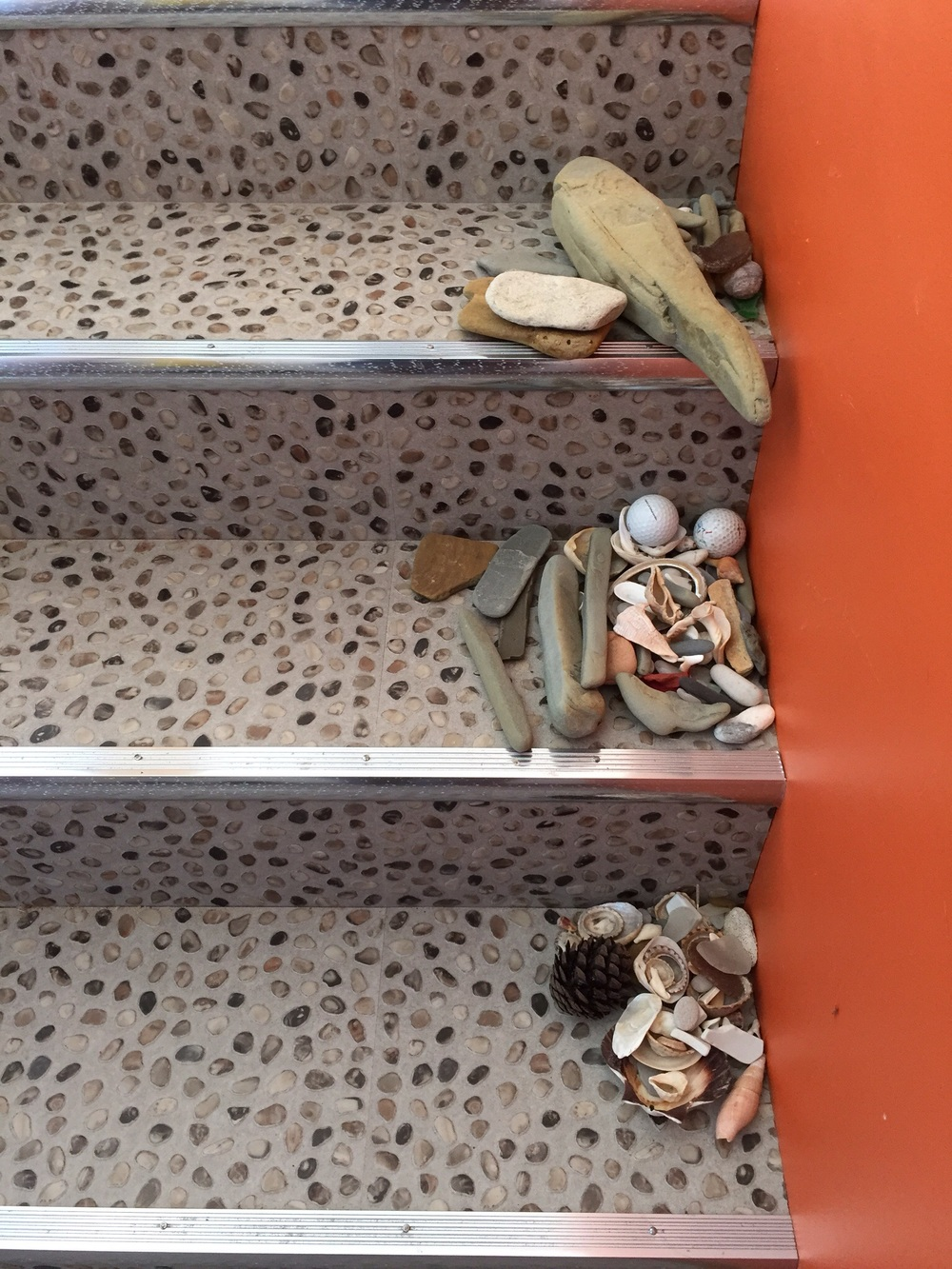 Every day more rocks shells and sea glass are deposited on the stairs - the beachcombing treaure is everywhere