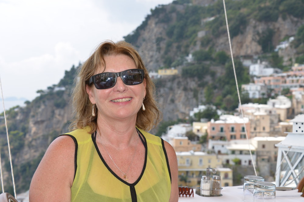 Some of you may even recognise the background - Positano Italy a table overlooking the coast all that was missing was Brad Pitt..
