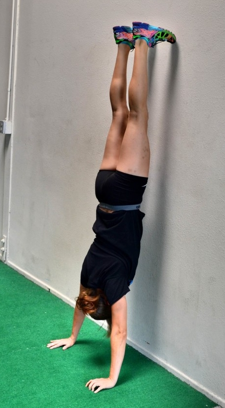 """Handstand from a wall walk. """"Nose and Toes"""" hold."""