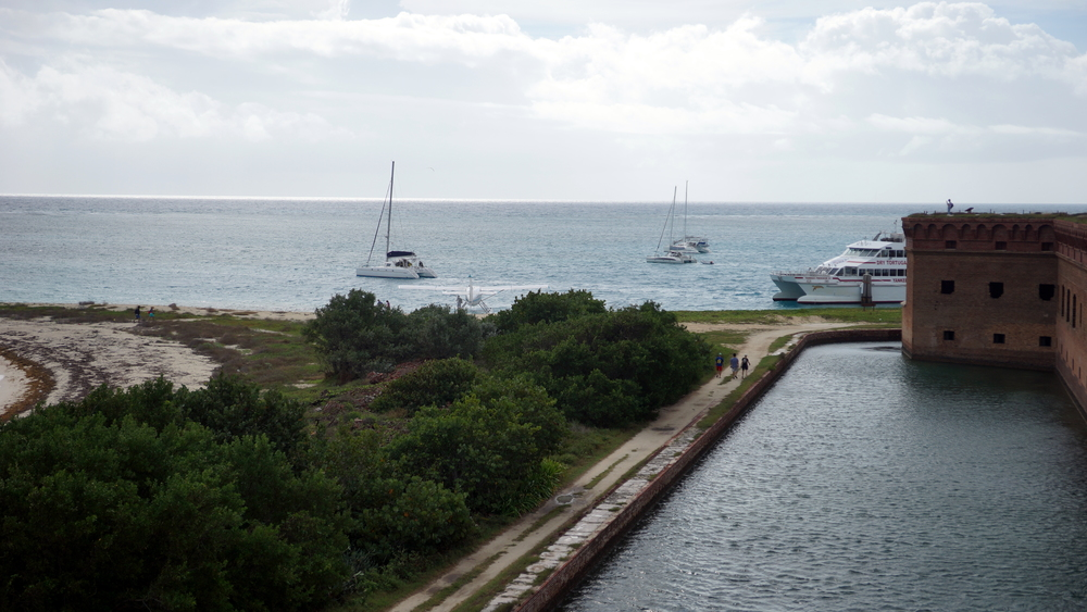 Ventenar anchored on the left, Ship-O-Fool, and the Dry Tortugas ferry docked at Fort Jefferson, Garden Island.