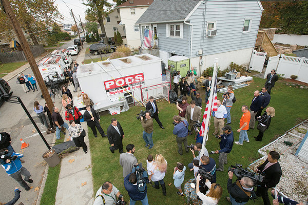 Governor Chris Christie surrounded by media and constituents after Sandy.