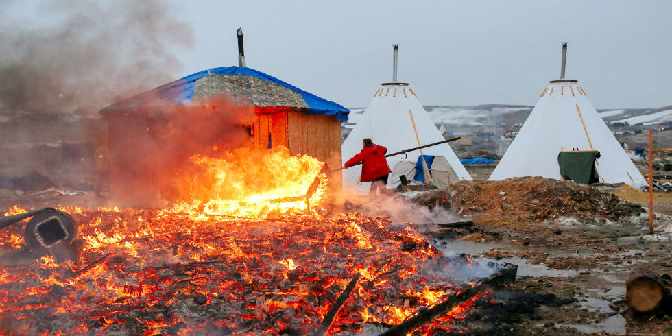 """The ongoing struggle will not go down in the flames at Oceti Sakowin,"" writes Ladha. (Photo: Stephen Yang/Getty Images)"