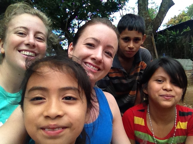 Volunteers with two of Irma's children and one of her nieces.