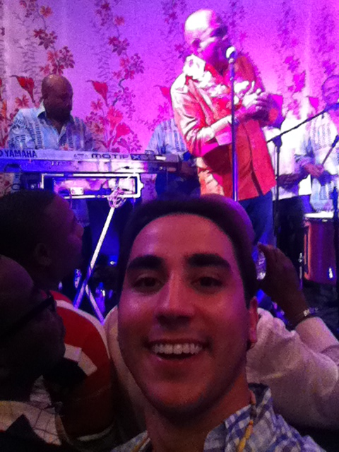 Dr Fernando Mariotto enjoys a performance by Haitian President Michel Martelly during a Carnival of Flowers party.
