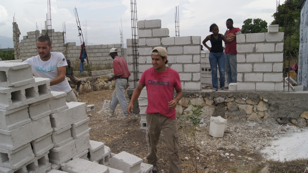 Bruno Gomes (left) and Rafael Matheus work on a Fuller Center home in Haiti.