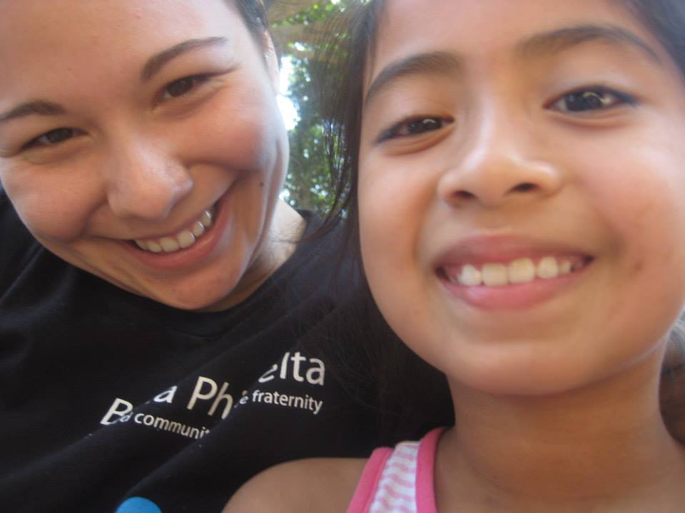 Allyson and one of the village children in Chiltiupán, El Salvador.