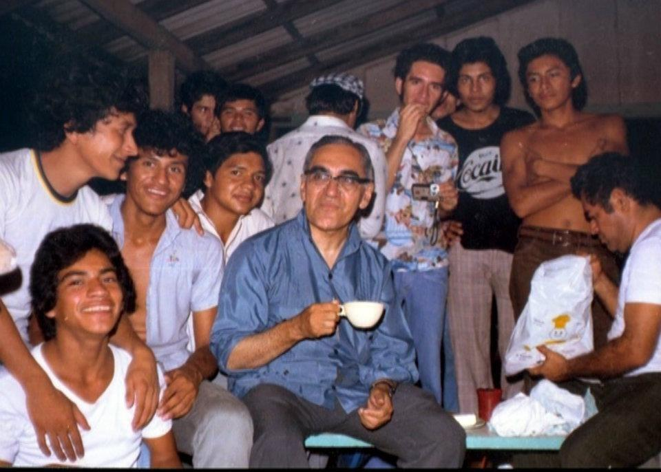 Archbishop Oscar Romero drinks coffee with a group of seminarians in El Salvador. (Photo credit:  Louis Ducharme )