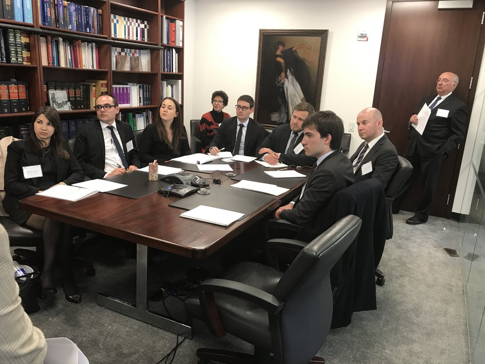 Law students from Université de Rennes I and Professor Yolande Sérandour listen to presentations by New York tax attorneys, moderated by  Stanley C. Ruchelman .