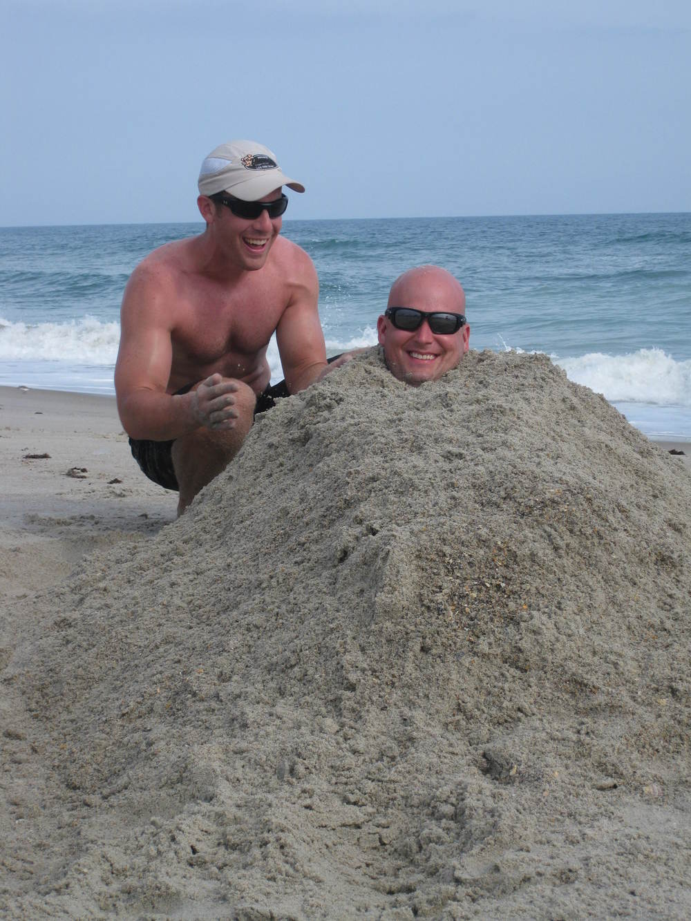 Burying_Andy_in_sand_at_beach.JPG