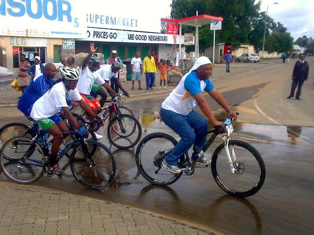 The Minister of Sports (white cap) testing out a bike.