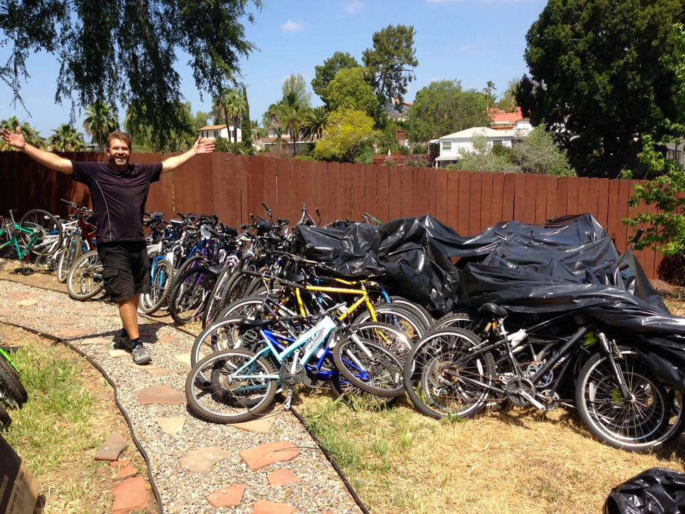 Mike's yard absolutely filled with donated bikes.