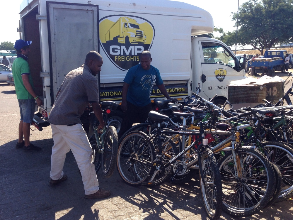 Loading bikes into the GMR truck to bring to the bus station.