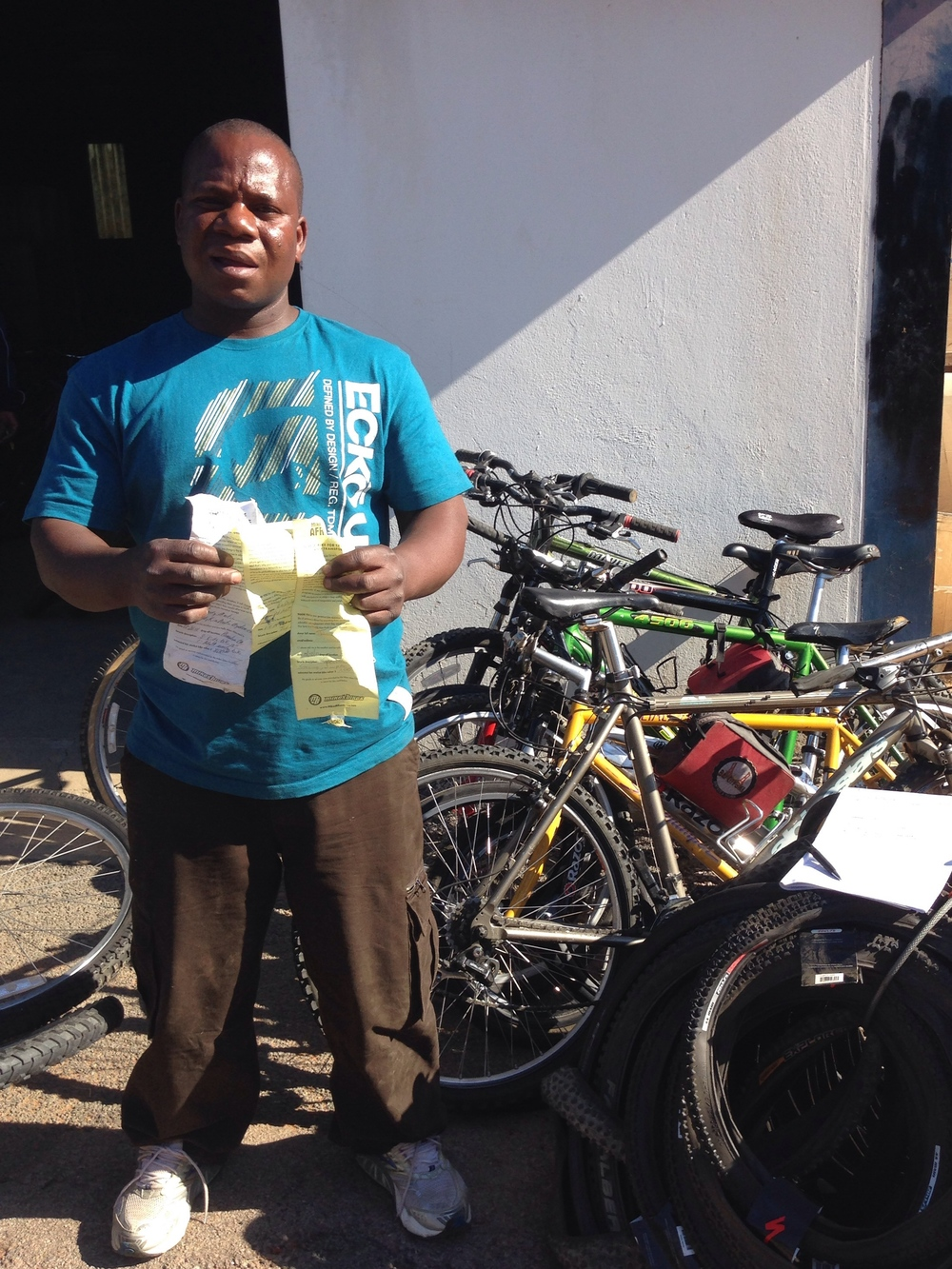 Charles with his new stock and slips from our bike donors in California.