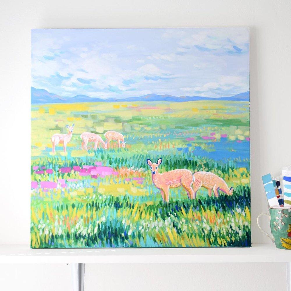 Painting of deer in a field
