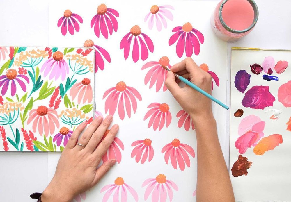 Pattern of pink painted daisies