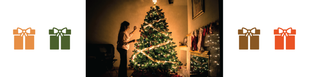 Photo of a Christmas tree with an orange glow in a dark room with associated color palette