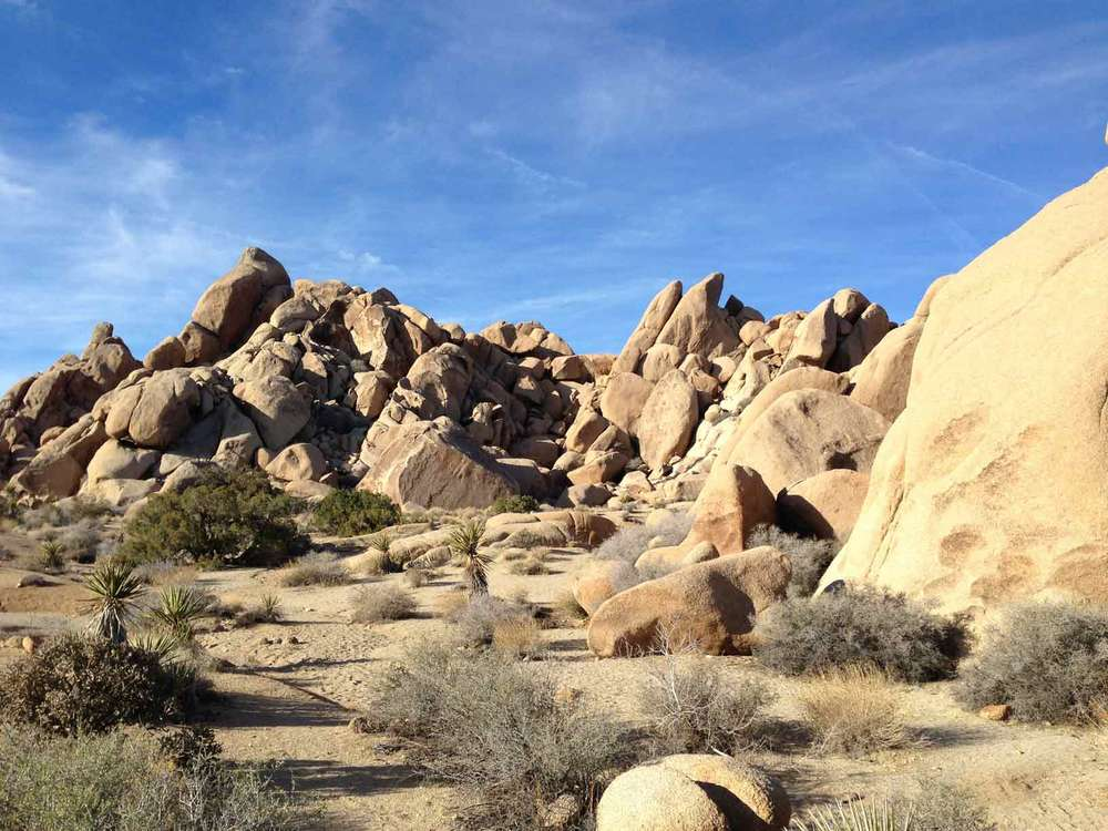 Joshua Tree, California. These stones stand about 35 feet tall. That's me on top of the tallest stone. See me?