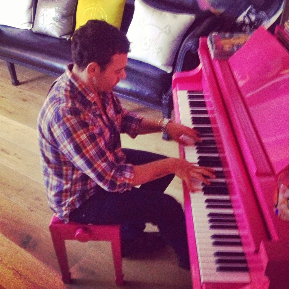 Mert Playing on my pink piano.