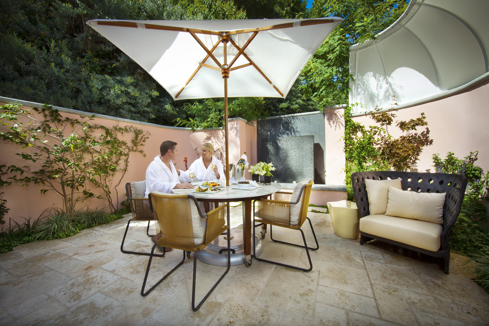 Couples Toasting.TheEnclavePatio.Hotel Bel-Air Spa by La Prairie.jpg