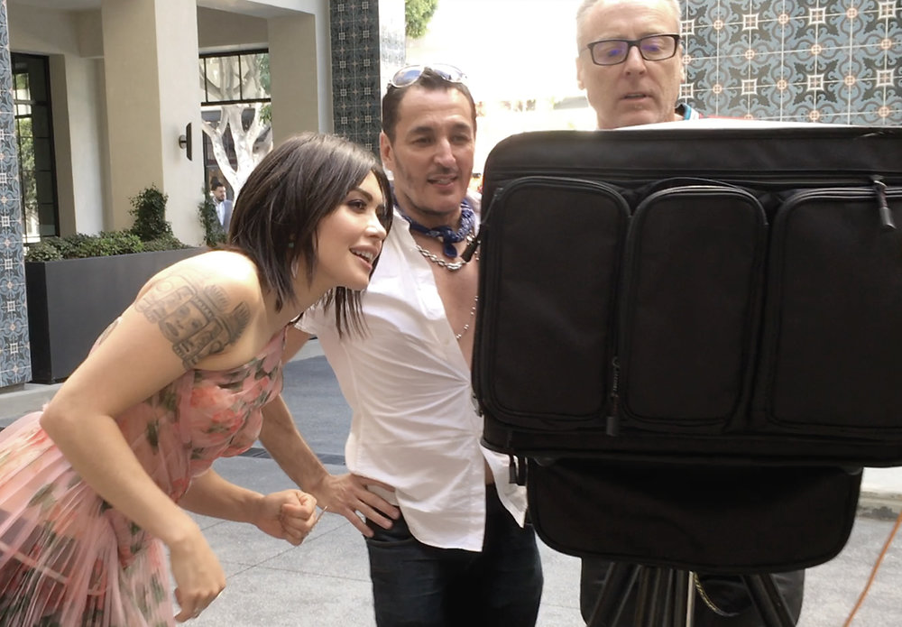 (l-r)  Daniella Pineda, photographer Robert Steinken, and lighting director Robert Morris, check photos on the monitor