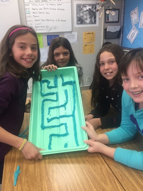 Students displaying their hypothetical watershed maze.