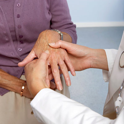 A 54-year-old woman went to see a chiropractor after having been diagnosed seven years prior with rheumatoid arthritis