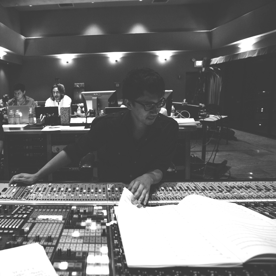 """Mixing engineer Satoshi Mark Noguchi has been working up a storm around Hollywood. After just under a decade in Los Angeles, the Seattle native's list of credits suggest that he does more mixing than sleeping. He is currently recording/mixing film scores and songs for artists such as Rob Simonsen, Nathan Whitehead, Joe Trapanese, Bret McKenzie, and Dia Frampton. In 2013 he was nominated for a CAS mixing award for Explosions in the Sky's score to the film """"Lone Survivor"""".      Some of Satoshi's most recent work can be heard on the playful tunes in """"Muppets Most Wanted"""" and the hard hitting """"The Raid 2: Berendal"""". Forthcoming work includes the sci-fi adventure """"Earth To Echo"""" and the thriller """"The Purge: Anarchy"""", in theaters in summer 2014.  - http://www.imdb.com/name/nm3827488/"""